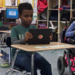 student with disabilities with a tablet