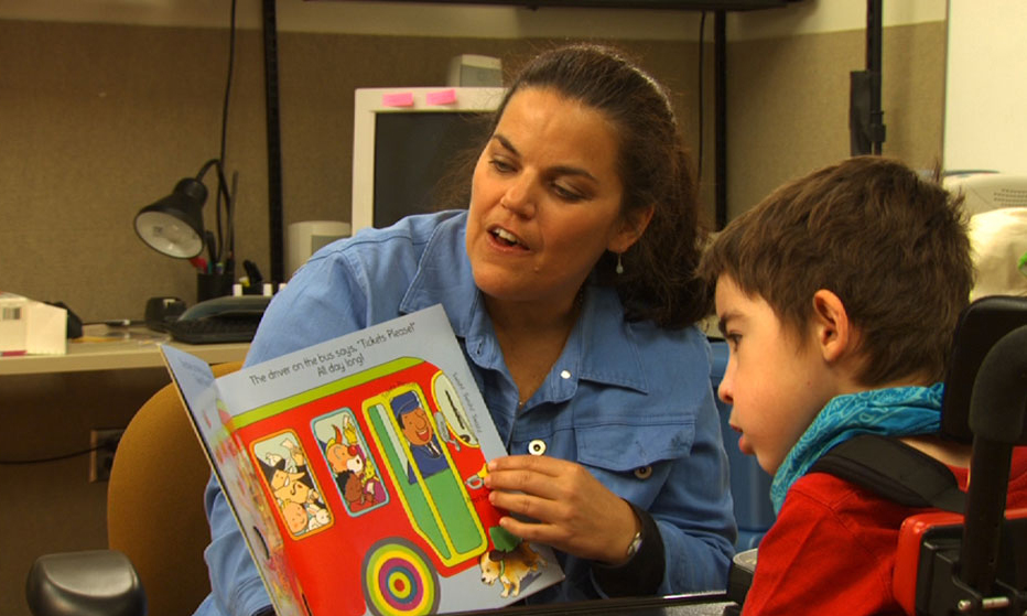teacher reading with a student